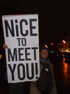 A protestor holds up a placard which reads: 'Nice to meet you!' Image: Lvova Anastasiya.