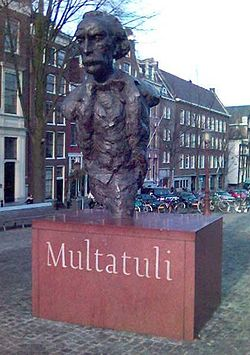 Statue of Multatuli on a square over the Singel canal in Amsterdam.