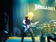 Mustaine with signature guitar.jpg