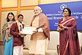 Narendra Modi presenting the National Bravery Awards 2015 to the children, in New Delhi on January 24, 2016. The Union Minister for Women and Child Development, Smt. Maneka Sanjay Gandhi is also seen (4).jpg