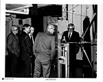 Neil Armstrong looking at a test apparatus.jpg