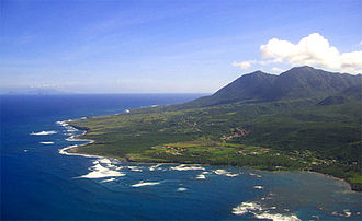 Nevis - The east coast of Nevis, partially protected by coral reefs. Long Haul Bay is seen in the foreground.