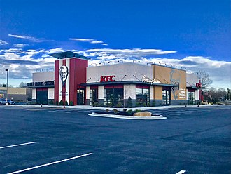 History of KFC - The old restaurant in Harrisburg, IL was torn down to make room for this brand new, grand KFC!