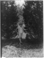 Nude youth in nature with palm frond by Fred Holland (1896).png