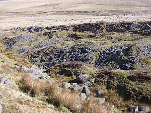 Dartmoor tin-mining - An example of the characteristic pattern of parallel ridges and scarp left by tin-streaming, east of Fox Tor.