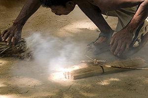 Orang Asal - An Orang asli starting a fire