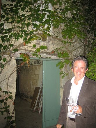 Bordeaux wine regions - Pascal Meli shows us the entrance to his cellar at Chateau Bujan in the Cotes de Bourg, Bordeaux, France.