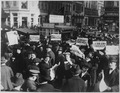 Peace rumor, New York. Crowd at Times Square holding up Extras telling about the signing of the Armistice. The... - NARA - 533477.tif