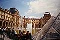 People in cour Napoléon, Louvre Museum, Paris 7 June 2000 02.jpg