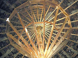 Pete French Round Barn - Interior ceiling of Pete French Round Barn shows the large single juniper center post and dimentonal wood lumber support structure