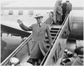 Photograph of President Truman waving from the steps as he prepares to board his airplane in Washington for a... - NARA - 200343.tif