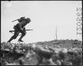 Photograph of a Marine Charging Japanese Machine Guns on Okinawa - NARA - 532554.tif