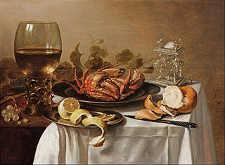 A still life with a roemer, a crab and a peeled lemon