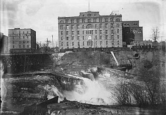 """Pillsbury Company - The Pillsbury """"A"""" Mill and neighboring Phoenix Mill in the early 1900s"""