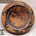 Pittore genucilia di sydney (attr.), piattello etrusco con testa femminile, cerveteri 330-310 ac ca., dalla banditaccia.jpg