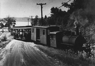 Huntsville and Lake of Bays Transportation Company - When re-engined, the Huntsville and Lake of Bays Railway called its train the Portage Flyer. Here the Flyer is seen pulling out of South Portage station.