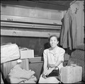 Poston, Arizona. Now that she's settled with baggage and ticket, Mrs. I Tanaka, is quite anxious to . . . - NARA - 539875.tif