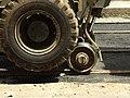 Praha, Smíchov, Anděl, rekonstrukce trati v Nádražní ulici, uchycení bagru na kolejnicích.JPG