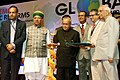 Pranab Mukherjee lighting the lamp at the inaugural session of Global Summit on 'Academics & Economic Reforms - Role of Cost & Management Accountants', organised by the Institute of Cost Accountants of India (ICAI).jpg