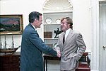 President George H. W. Bush visits with Robert Redford.jpg