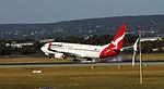 Qantas 737-800 landing runway 03 (8117771186).jpg