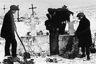"Collectivization in the Soviet Union - YCLers seizing grain from ""kulaks"" which was hidden in the graveyard, Ukraine"