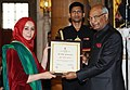 Ram Nath Kovind presenting the Nari Shakti Puruskar for the year 2017 to Ms. Mehvish Mushtaq, Srinagar, J&K, at a function, on the occasion of the International Women's Day, at Rashtrapati Bhavan, in New Delhi.jpg