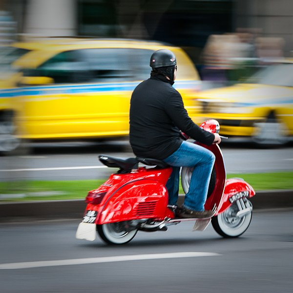 File:Red scooter rider Avenida Do Mar, Funchal, Madeira Island.jpg