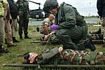 Rhode Island National Guardsman and Marine prepare CAP cadets for evacuation drill.JPG