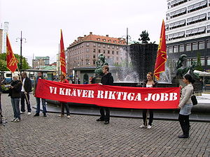 "Revolutionary Communist Youth (Sweden) - RKU in protest against youth unemployment in Järntorget, Gothenburg. The banner reads ""We demand real jobs""."