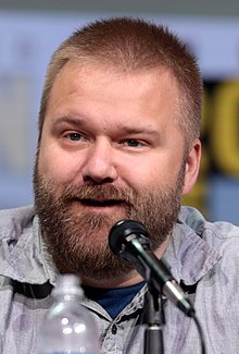 Kirkman at a microphone