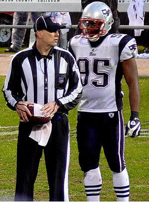 John Parry (American football official) - Parry (left) with Rosevelt Colvin in 2008.