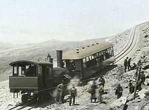 Pikes Peak - Manitou and Pike's Peak Railway train rounding Windy Point, around 1900.