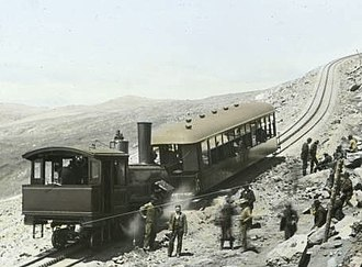 Pikes Peak - Manitou and Pike's Peak Railway train rounding Windy Point, around 1900.