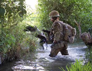 Royal Air Force Police - A Royal Air Force Police Dog Handler attached to 42 Commando, on patrol in Helmand Province, Afghanistan (2011)