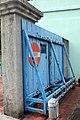 Rusting blue roller back gate, Haw Par Villa (14813764143).jpg