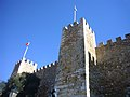 São Jorge Castle and the Flag of Portugal.jpg