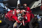 Sailors prepare to load ordnance on an F-A-18E Super Hornet. (27682176360).jpg