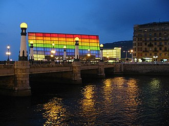 Kursaal Congress Centre and Auditorium - Night view of Kursaal Palace lit up with Rainbow flag colors.