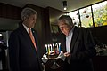 Secretary of State John Kerry, left, surprises Secretary of Defense Chuck Hagel, who blows out the candles of his birthday cake in honor of his Oct. 4 birthday in Tokyo Oct. 3, 2013 131003-D-BW835-2054.jpg