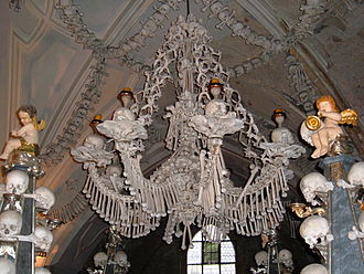 Ossuary - A chandelier of Sedlec Ossuary, Czech Republic, made of skulls and bones.