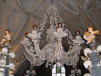 Ossuary - A chandelier of Sedlec Ossuary, Czech Republic, made of skulls and bones.