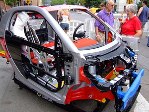 A cutaway of a Smart car showing the structure