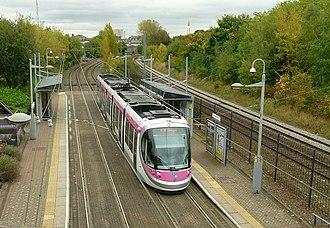 Soho Benson Road tram stop - Urbos 3 tram calling at Soho Benson Road.