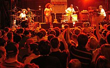 Soulive and Reggie Watts performing at the Rochester International Jazz Festival in 2006