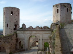 "The Porta di Venere (Venus' Gate), from the 1st century BC. It has two dodecagonal towers called ""Propertius' Towers""."