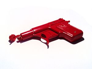 Spud gun - A typical factory-made toy die-cast spud gun. The cap attached to the muzzle converts it into a water pistol.