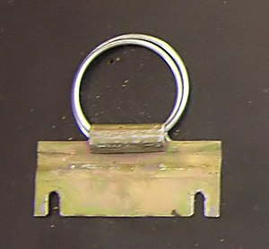 Sputnik 1 - This metal arming key is the last remaining piece of the first Sputnik satellite. It prevented contact between the batteries and the transmitter prior to launch. Currently on display at the Smithsonian National Air and Space Museum.