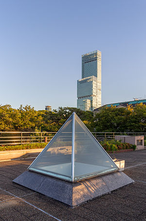 Square pyramid light tube with Abeno Harukas (The tallest building in Japan.) in sunset.