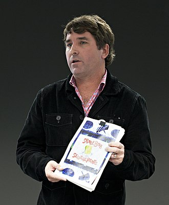Stephen Hillenburg - Hillenburg, holding the SpongeBob SquarePants bible, in 2011